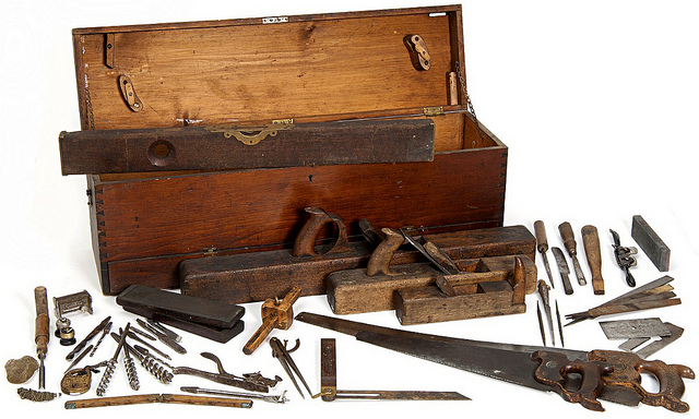 Old-fashioned toolbox with a variety of wood-working tools