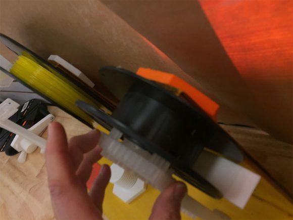 Closeup of tensioner in the spool