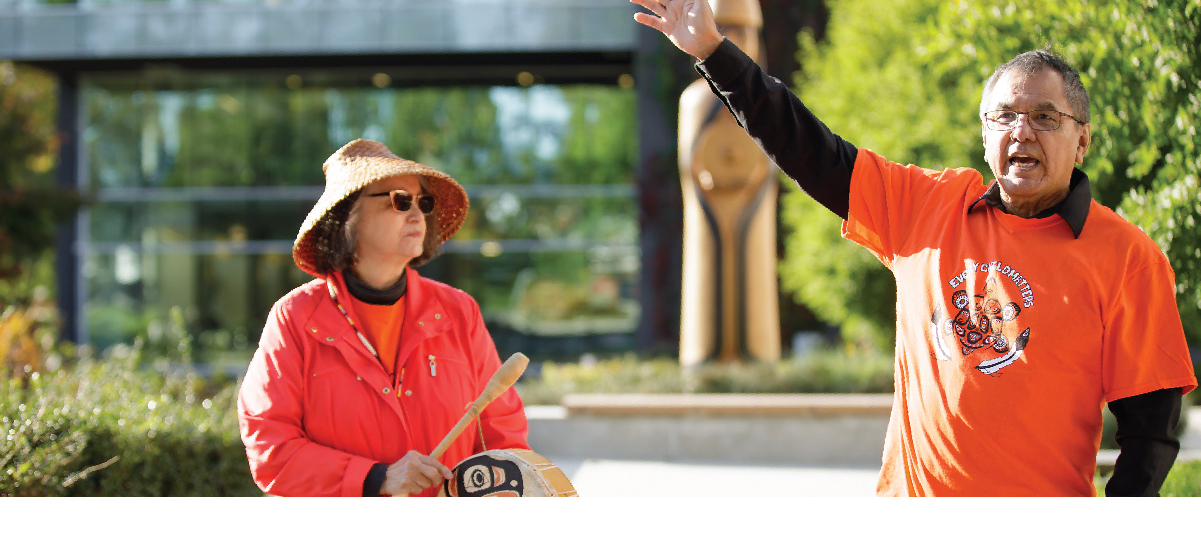 Two people outside of Langara College on Orange Shirt Day 2019, which is a day dedicated to commemorating the children affected by residential schools.
